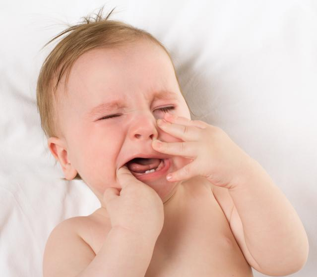square of A Teething Child is Rarely Happy to Be Experiencing the Process